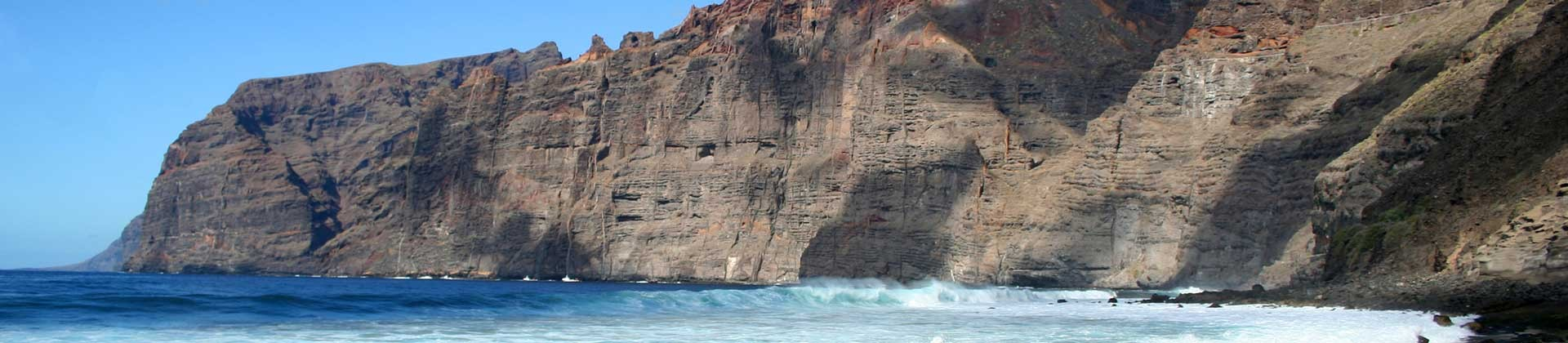 https://www.goodmorningtenerife.com/wp-content/uploads/2014/08/03_slide_los_gigantes_GM_Tenerife-1920x420.jpg